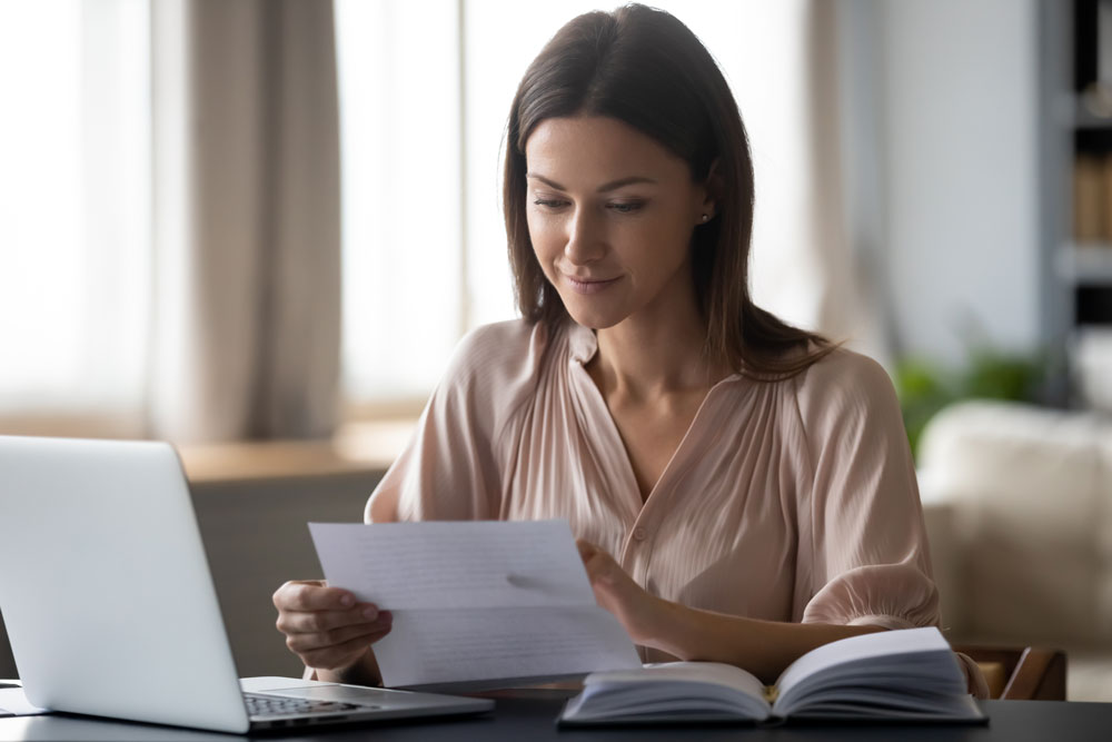 women reviewing insurance quote
